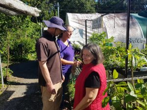 Yandina Community Gardens happy customers in the nursery